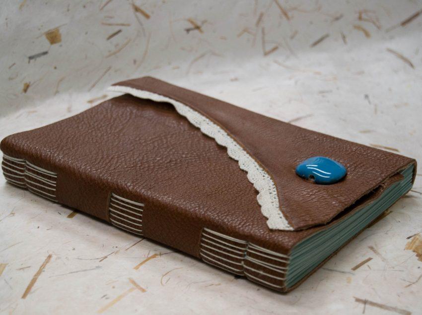 Come stampare su un libro rilegato la fincatura di un modulo?